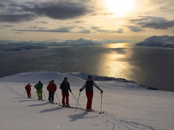 On our way to Trolltinden on Arnøya with the Lyngen fjord in the background.