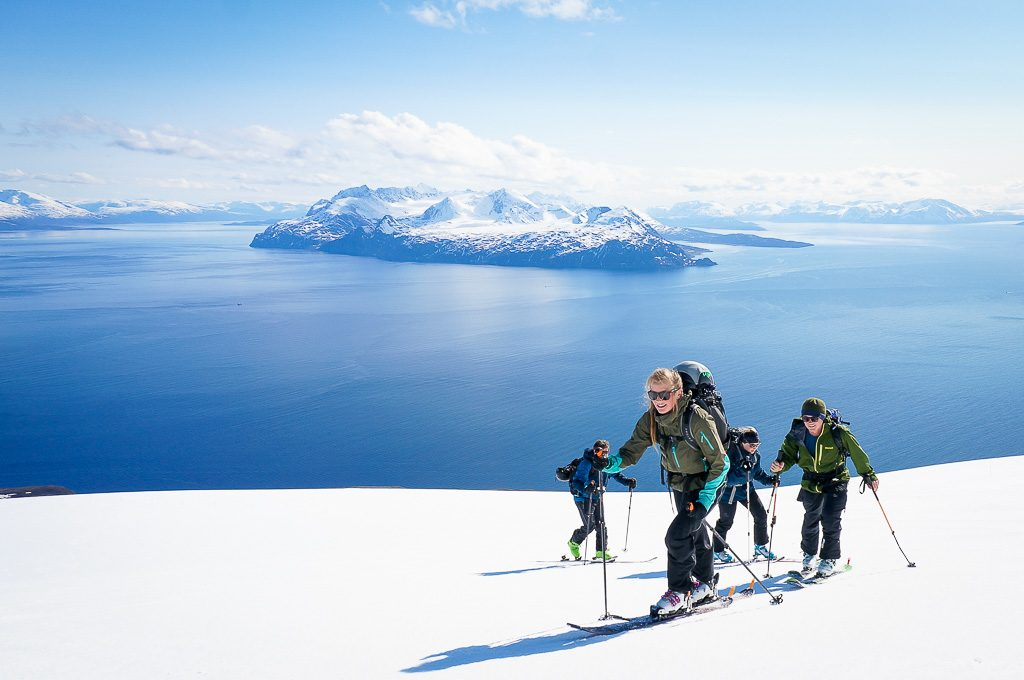 The Lyngen alps in the back when ski touring on the classic Trolltinden at Arnøya. All groups get a day with our boat accessed ski touring included in our Lyngen ski weeks.